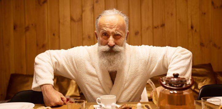 bearded-senior-man-drink-tea-after-procedure-sauna-concept-healthy-lifestyle-2